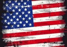 Eine benutzte patriotische US-Markierungsfahne mit einer Beschaffenheit Lizenzfreie Stockfotografie