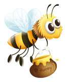 Eine Biene, die einen Honig trägt Stockbild