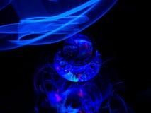 Eine blaue Wolke fängt an, die reflektierende Diskette zu bedecken und reflektierend stockfoto