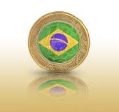 Eine brasilianische wirkliche Flagge in einer Münze Lizenzfreies Stockbild