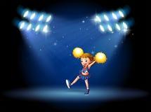 Eine Cheerleader, die am Stadium mit Scheinwerfern durchführt Stockbilder
