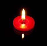 Eine conflagrant Kerze Lizenzfreies Stockbild