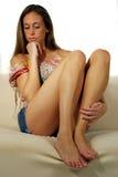 Eine durchdachte junge Frau Stockbild
