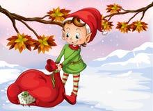 Eine Elfe, die eine Tasche von Geschenken hält Stockfoto