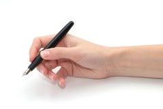 Eine Feder in einer Hand Lizenzfreie Stockfotografie