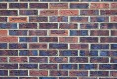Eine feste Backsteinmauer-Beschaffenheit/ein Hintergrund Stockfotos