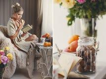 Eine Frau mit einem Buch und ein reifer Apfel in einer Hand Lizenzfreies Stockbild
