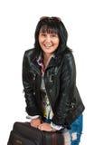 Eine Frau mit einem Koffer Stockfoto