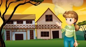 Eine Frau mit einem Schneider, der vor den Häusern steht Lizenzfreies Stockfoto