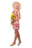 Eine Frau mit gelben Blumen. Stockfotografie