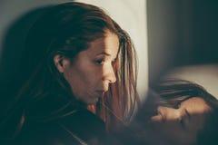 Eine Frau niedergedrückt Stockfoto