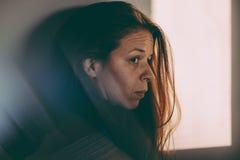 Eine Frau niedergedrückt Lizenzfreie Stockfotografie