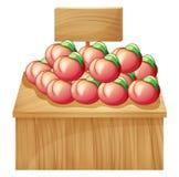 Eine Frucht über einem Holztisch mit einem hölzernen Schild Stockbild