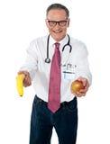 Eine Frucht ein Tag hält Doktor weg Lizenzfreies Stockfoto
