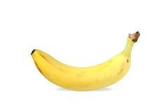 Eine gelbe Banane getrennt stockfotografie