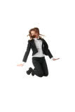 Eine Geschäftsfrau, die mit den Händen in der Luft springt Stockbilder