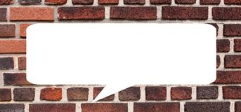 Eine Gesprächsblase auf einer Backsteinmauer Lizenzfreies Stockfoto