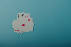 Eine gewinnende Pokerhand von vier Spielkarten der Asse Stockbilder