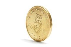 Eine Goldporzellanmünze Stockfotografie