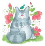 Eine große graue Katze, die mit einem Vogel spielt Lizenzfreie Stockfotos
