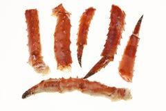 Eine große Phalanx von Füßen eines frischen gekochten Krebsfleischs der Krabbe Hummerbeinnahaufnahme auf einem weißen Hintergrund Stockbild