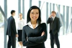 Eine Gruppe von vier jungen Geschäftsleuten Lizenzfreie Stockfotos