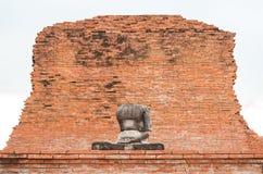 Eine Hälfte des alten Buddha-Statuenhintergrundes Lizenzfreies Stockbild