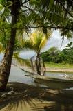Eine Hängematte im Schatten der Palme Stockfotografie