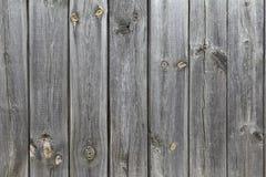 Eine hölzerne Wand von alten, grauen Brettern Retro- Hintergrund von strukturierten Brettern für Ihr Design Stockfoto
