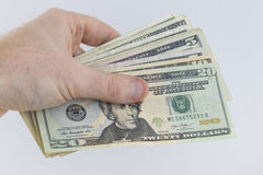 Eine Hand, die amerikanisches Bargeld hält lizenzfreie stockfotos