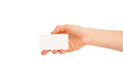 Eine Hand, die ein weißes Stück Pappe hält Stockfotografie