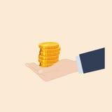 Eine Hand, die Münzen hält Stockfoto