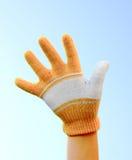 Eine Hand gekleidet in einem Handschuh Stockbild