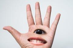 Eine Hand haben Auge mit smiley Lizenzfreies Stockbild