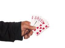 Eine Hand mit Spielkarten stockbilder