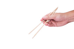 Eine Hand unter Verwendung der Ess-Stäbchen Stockfotos
