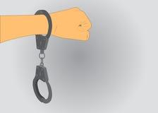 Eine Handschelle auf ihrer Hand Stockfotos