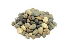Eine Handvoll runde Steine Stockbilder