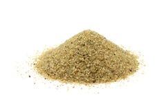 Eine Handvoll Sandkorn lizenzfreie stockfotografie