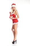 Eine junge blonde Frau in der erotischen Weihnachtswäsche Stockfoto