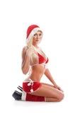 Eine junge blonde Frau in der Weihnachtswäsche Lizenzfreie Stockbilder