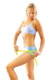 Eine junge blonde messende Taille stockbild