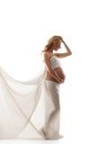 Eine junge blonde schwangere kaukasische Frau im Weiß Stockbild