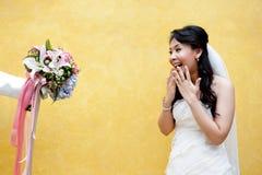 Eine junge Braut in der Überraschung Stockfotografie