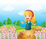 Eine junge Dame im Garten Stockbild