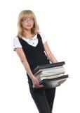 Eine junge Geschäftsfrau mit einem Satz Büchern Stockfotografie