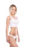 Eine junge und sexy blonde Frau, die in der weißen Wäsche aufwirft Lizenzfreie Stockfotografie
