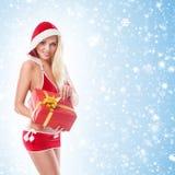 Eine junge und sexy blonde Holding ein Geschenk Stockfotos