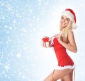 Eine junge und sexy blonde Holding ein Geschenk Stockfotografie