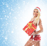 Eine junge und sexy blonde Holding ein Geschenk Stockbild